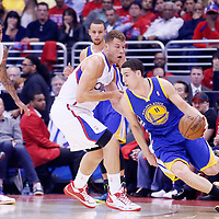 21 April 2014: Golden State Warriors guard Klay Thompson (11) drives past Los Angeles Clippers forward Blake Griffin (32) during the Los Angeles Clippers 138-98 victory over the Golden State Warriors, during Game Two of the Western Conference Quarterfinals of the NBA Playoffs, at the Staples Center, Los Angeles, California, USA.
