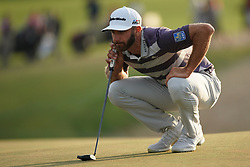 June 16, 2018 - Southampton, NY, USA - Dustin Johnson lines up a putt on the 18th green during the third round of the 2018 U.S. Open at Shinnecock Hills Country Club in Southampton, N.Y., on Saturday, June 16, 2018. (Credit Image: © Brian Ciancio/TNS via ZUMA Wire)