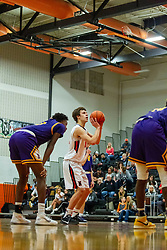 31 January 2020: Boys Basketball game between the Bloomington Raiders and the NCHS Ironmen in Normal Community High School, Normal IL