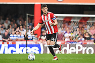 Brentford Defender John Egan (14) in action during the EFL Sky Bet Championship match between Brentford and Queens Park Rangers at Griffin Park, London, England on 21 April 2018. Picture by Stephen Wright.