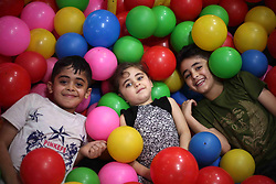 June 16, 2018 - Gaza City, Gaza Strip - Palestinian children celebrate on the second day of Eid al-Fitr holiday which marks the end of the Muslim holy month of Ramadan. Eid al-Fitr marks the end of Muslim's holy fasting month of Ramadan when faithfuls abstain from eating, drinking, smoking and sexual activities from dawn to dusk  (Credit Image: © Mahmoud Ajour/APA Images via ZUMA Wire)