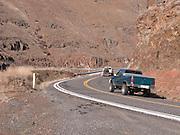 Two pickup trucks climb Rattlesnake Grade from the Grande Ronde River Canyon, Asotin County, WA, USA