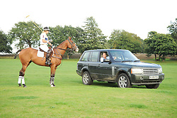 The MARCHIONESS OF MILFORD-HAVEN on polo pony talks to her husband The MARQUESS OF MILFORD-HAVEN in his Range Rover at the 4th Jaeger-LeCoultre Polo Cup in aid of the James Wentworth-Stanly Memorial Fund held at Coworth Park, Ascot, Berkshire on 10th September 2010.