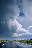 Thunderstorm clouds (cumulonimbus) over road in the Coconino Plateau,  near the Grand Canyon, ARIZONA