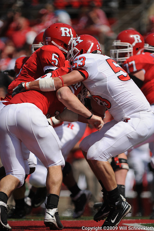 Apr 18, 2009; Piscataway, NJ, USA; Rutgers LB Jim Dumont (53) is blocked by RB Joe Martinek (38) during the first half of Rutgers' Scarlet and White spring football scrimmage.