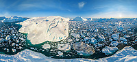 Aerial view of big glacier structures and icebergs in Greenland.