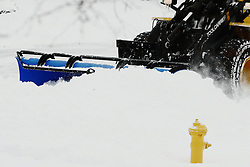 01 February 2008: An end loader with a snow plow clears the freshly fallen snow from a cul-de-sac in a subdivision in Bloomington Illinois