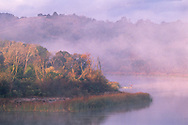 Misty morning sunrise and fisherman at the Lafayette Reservoir, Contra Costa County, California