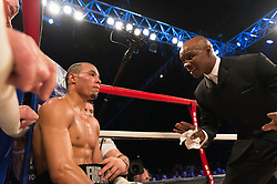 © Licensed to London News Pictures. 26/03/2016.  Boxer CHRIS EUBANK speaks to his son ChRIS EUBANK JR during his boxing fight against NICK BLACKWELL ,defending British middleweight champion at the SSE Arena, Wembley.   Twenty-five-year-old Blackwell is one of the most exciting fighters in the country and won the British middleweight title in May 2015.  He has since defended his title twice.  London, UK. Photo credit: Ray Tang/LNP