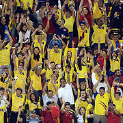 Colombia fans perform the Mexican wave during the Columbia Vs Canada friendly international football match at Red Bull Arena, Harrison, New Jersey. USA. 14th October 2014. Photo Tim Clayton