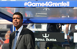 2 September 2017 - Charity Football - Game 4 Grenfell - Chris Kamara stands in the dug out beneath the hashtag Game 4 Grenfell - Photo: Charlotte Wilson