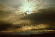 Light rays through clouds.