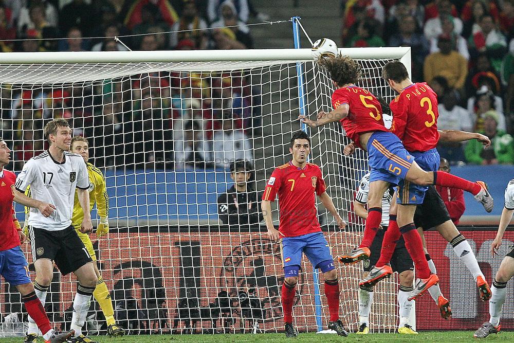 07-07-2010 VOETBAL: FIFA WORLDCUP 2010 SPANJE - DUITSLAND: DURBAN<br /> Halve finale WC 2010 - Spanje wint met 1-0 van Duitsland / Carles Puyol of Spain ( Matchwinner ) trifft per Kopf zum 0:1 fuer Spanien - li Per Mertesacker ( Werder Bremen #17 ) Manuel Neuer ( FC Schalke 04 #01 ) <br /> ©2010-FRH- NPH/ Kokenge (Netherlands only)