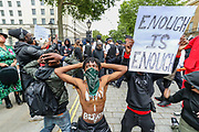 June 3, 2020, London, England, United Kingdom: Protesters gather during a demonstration in Whitehall road nearby Downing Street in London on Wednesday, June 3, 2020, over the death of George Floyd, a black man who died after being restrained by Minneapolis police officers on May 25. Protests have taken place across America and internationally after a white Minneapolis police officer pressed his knee against Floyd's neck while the handcuffed black man called out that he couldn't breathe. The officer, Derek Chauvin, has been fired and charged with murder. (Credit Image: © Vedat Xhymshiti/ZUMA Wire)