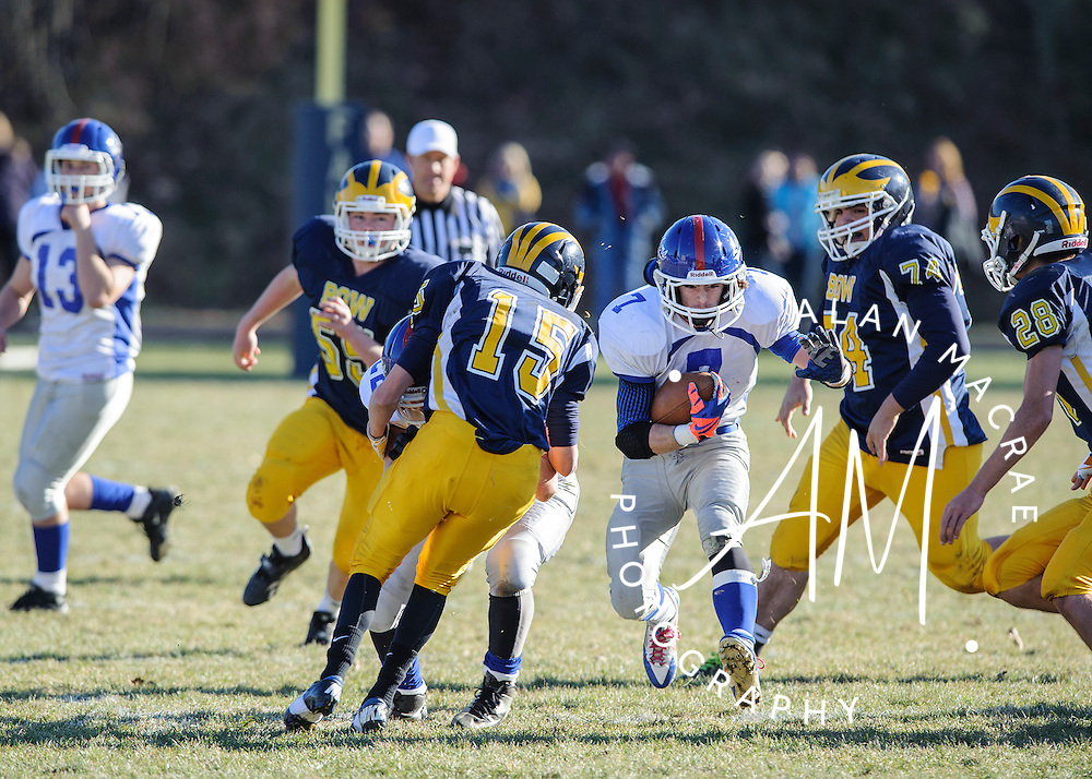 Inter Lakes / Moultonborough sophomore Nick Brothers charges through Bow's defensive line during the NHIAA Division III semi-final game at Bow on Saturday, November 16, 2013.  (Alan MacRae/for the Laconia Daily Sun)