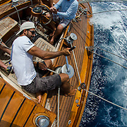 On the deck of The Blue Peter. Back in the 60s, classic yachts, which were gathered in English Harbour Antigua, had begun chartering and the captains and crews challenged each other to a race down to Guadeloupe and back to celebrate the end of the charter season. From this informal race, Antigua Race Week was formalised in 1967, and in those days all of the yachts were classics. As the years grew on, the classic yachts were slowly outnumbered but the faster sleeker modern racing yachts and 24 years later the Classic Class had diminished to a few boats and was abandoned in 1987. However this same year seven classic yachts turned out and were placed in Cruising Class 3 with the bare boats. The class was so unmatched that it was downright dangerous, so Captain Uli Pruesse hosted a meeting onboard Aschanti of Saba with several classic skippers and in 1988 the Antigua Classic Yacht Regatta was born, with seven boats.<br />