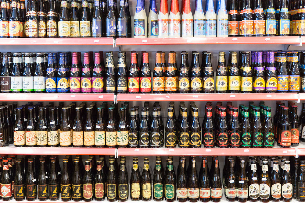 Belgian beers and famous Leffe lager beer on shelves with ale and porter in shop in Bruges - Brugge - Belgium