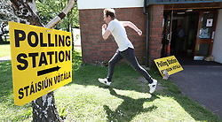 A man leaving as polling station in Dublin, as the country goes to the polls to vote in the referendum on the 8th Amendment of the Irish Constitution.