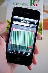 Scanning barcode on packet of tea to find price comparison in shop on an iPhone 4G smart phone