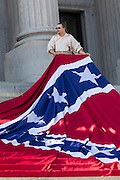 Civil war re-enactors position a gigantic Confederate flag on the steps of the South Carolina State Capitol building May 2, 2015 in Columbia, SC. Confederate Memorial Day is a official state holiday in South Carolina and honors those that served during the Civil War.