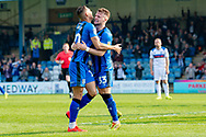 Gillingham FC midfielder Mark Byrne (33) scores a goal (1-1) and celebrates with team mate during the EFL Sky Bet League 1 match between Gillingham and Rochdale at the MEMS Priestfield Stadium, Gillingham, England on 30 March 2019.