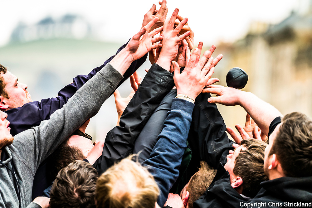 Jedburgh, Scottish Borders, UK. 22nd February 2018. The annual game of hand ba' in the Scottish town of Jedburgh takes place every year the Thursday after Fastern's E'en. The tradition derives from 1548 when a party of Scots recaptured Ferniehirst Castle, a mile south of Jedburgh and used an Englishman's head in a celebratory game after the battle. Those born south of the towns Mercat Cross play for the 'Uppies' scoring at the Castle Jail, conversely those born North play for the Doonies, scoring near the River Jed. The knack of the game is to smuggle the ball through team members, through any means possible, there are no rules as such really.