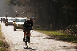 Chasing between the cars to catch back with the peloton - Drentse 8, a 140km road race starting and finishing in Dwingeloo, on March 13, 2016 in Drenthe, Netherlands.