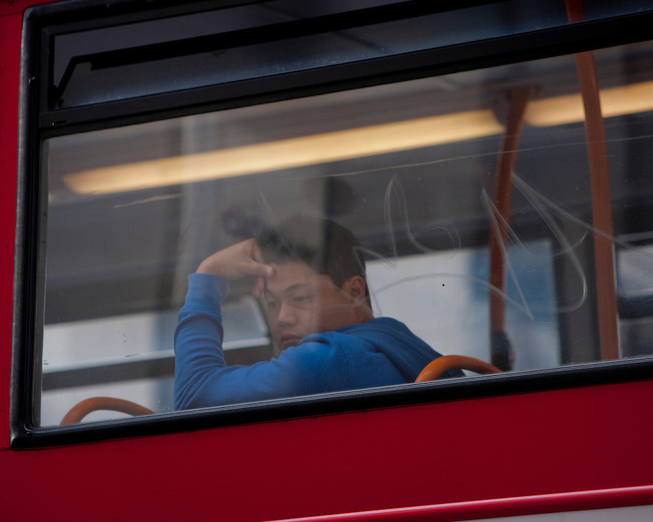A man looking out from a bus