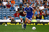 James Tarkowski of Brentford looks to get away from Lukas Jutkiewicz of Burnley. Skybet football league championship match, Burnley  v Brentford at Turf Moor in Burnley, Lancs on Saturday 22nd August 2015.<br /> pic by Chris Stading, Andrew Orchard sports photography.