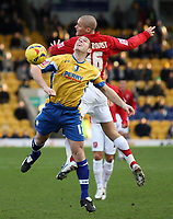 Photo: Paul Thomas.<br /> Mansfield Town v Walsall. Coca Cola League 2. 20/01/2007.<br /> <br /> Jake Buxton (Yellow) of Mansfield wins the ball from Par Cederquvist.