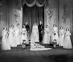 File photo dated 20/11/47 of Princess Elizabeth and the Duke of Edinburgh with their eight bridesmaids in the Throne Room at Buckingham Palace on their wedding day. Issue date: Friday April 9, 2021. PA Photo See PA story ROYAL Philip Wedding. Photo credit should read: PA/PA Wire