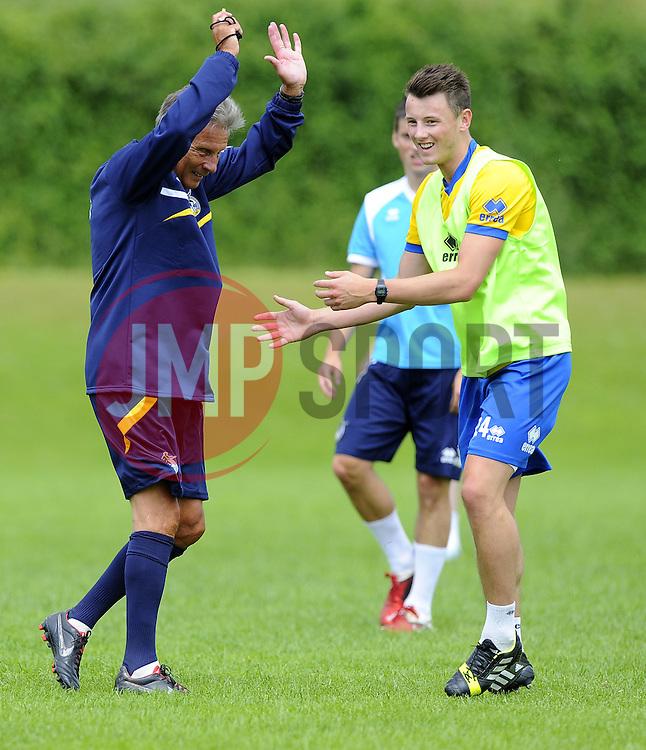 Bristol Rovers players struggle to avoid Bristol Rovers Manager, John Ward - Photo mandatory by-line: Joe Meredith/JMP - Tel: Mobile: 07966 386802 24/06/2013 - SPORT - FOOTBALL - Bristol -  Bristol Rovers - Pre Season Training - Npower League Two