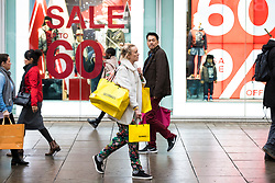 © Licensed to London News Pictures. 21/12/2017. London, UK. Shoppers on Oxford Street in central London on 'Panic Thursday', shortly before Christmas. Retailers are expecting an extremely busy day. Photo credit: Rob Pinney/LNP