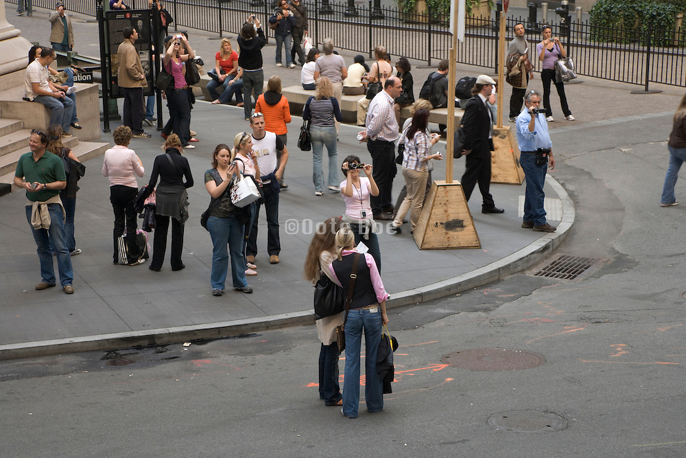 tourism in NY on the corner of Wall street and the Stock exchange