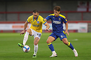 Brighton and Hove Albion midfielder Andrew Crofts (48) battles with AFC Wimbledon midfielder Alex Woodyard (4) during the EFL Trophy Southern Group G match between AFC Wimbledon and Brighton and Hove Albion U21 at The People's Pension Stadium, Crawley, England on 22 September 2020.