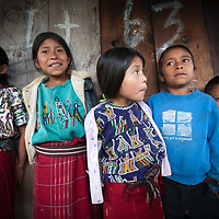 Maya Ixil children during a meeting in Turanza, Nebaj, Guatemala. People had gathered to share experience and learning on food security and nutrition in the region. Under Informed Consent rules, the parents of the children would have to be tracked down to give their consent for this photo to be taken or used. The assumption is that without informed consent, the photograph shows the children in an undignified way, or it puts them in danger.