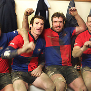 Andrew Hore (Centre, right) and Charlie Hore (centre, left) celebrate their teams victory after Maniototo defeated Arrowtown in the Central Otago final at Ranfurly. South Island, New Zealand, 9th June 2011