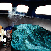An illegal immigrant from Algeria hides in a canal boat in central Amsterdam. .Picture taken 2002 by Justin Jin. ..