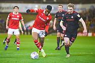 Mamadou Thiam of Barnsley (26) and Grant Leadbitter of Sunderland (23) in action during the EFL Sky Bet League 1 match between Barnsley and Sunderland at Oakwell, Barnsley, England on 12 March 2019.