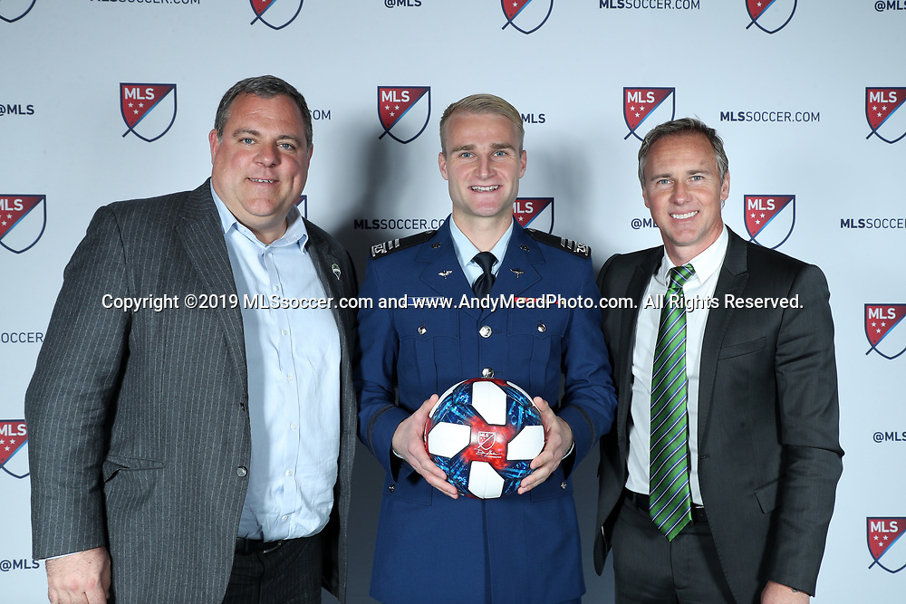 CHICAGO, IL - JANUARY 11: Tucker Bone was taken with the 20th overall pick by Seattle Sounders FC. With general manager Garth Lagerwey (left) and sporting director Chris Henderson (right). The MLS SuperDraft 2019 presented by adidas was held on January 11, 2019 at McCormick Place in Chicago, IL.