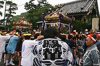 "Gosho Shrine Matsuri, Kamakura - Japanese festivals are traditional festive occasions. Some festivals have their roots in Chinese festivals but have undergone dramatic changes as they mixed with local customs.  Matsuri is the Japanese word for a festival or holiday. In Japan, festivals are usually sponsored by a local shrine or temple, though they can be secular..There is no specific matsuri days for all of Japan; dates vary from area to area, and even within a specific area, but festival days do tend to cluster around traditional holidays such as Setsubun or Obon. Almost every locale has at least one matsuri in late summer or autumn, usually related to the harvests. Matsuri almost always feature processions which include elaborate floats and ""mikoshi"" or portable shrines which are paraded around the neighborhood, and sometimes even into the ocean along the coast."