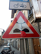 Licking is forbidden graffiti on a traffic sign in Florence, Italy