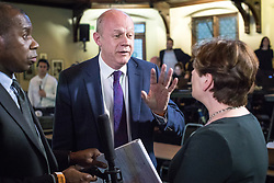 © Licensed to London News Pictures. 31/05/2017. Cambridge, UK. Secretary of State for Work and Pensions Damian Green (C) debates with Shadow Foreign Secretary Emily Thornberry (R) in the spin room at Cambridge University Union after the BBC General Election Debate. Photo credit: Rob Pinney/LNP