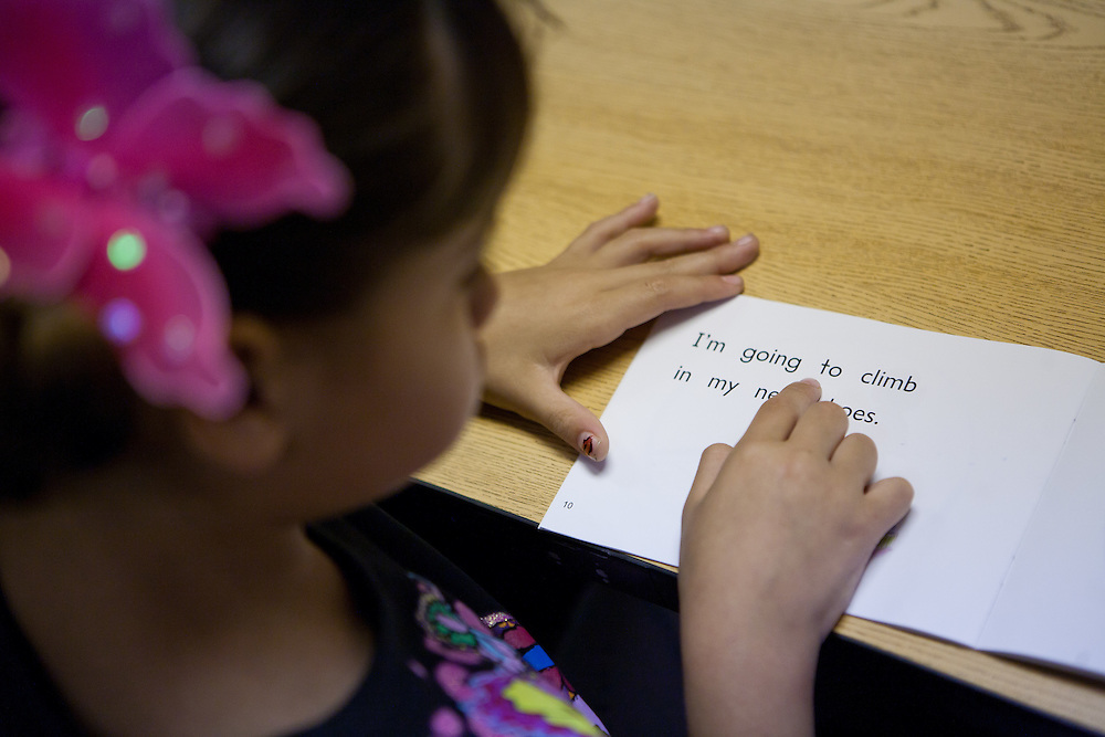 Lovington schools 1st grade student Alexa Rodriquez works with reading specialist Shawnlee Caballero (unseen). The schools in Lea County are using Recovery and Reinvestement funds to pay for much needed teachers and specialists like Cabalero.