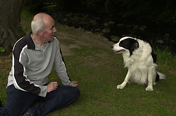 Eddie Sander with his Dogs Jackson and Inka<br /><br />18 June 2004<br /><br />Copyright Paul David Drabble<br /> [#Beginning of Shooting Data Section]<br />Nikon D1 <br /> Focal Length: 25mm<br /> Optimize Image: <br /> Color Mode: <br /> Noise Reduction: <br /> 2004/06/18 10:20:54.5<br /> Exposure Mode: Programmed Auto<br /> White Balance: Auto<br /> Tone Comp: Normal<br /> JPEG (8-bit) Fine<br /> Metering Mode: Spot<br /> AF Mode: AF-S<br /> Hue Adjustment: <br /> Image Size:  2000 x 1312<br /> 1/200 sec - F/7.1<br /> Flash Sync Mode: Front Curtain<br /> Saturation: <br /> Color<br /> Exposure Comp.: 0 EV<br /> Auto Flash Mode: External<br /> Sharpening: Normal<br /> Lens: 17-35mm F/2.8-4<br /> Sensitivity: ISO 200<br /> Image Comment: <br /> [#End of Shooting Data Section]