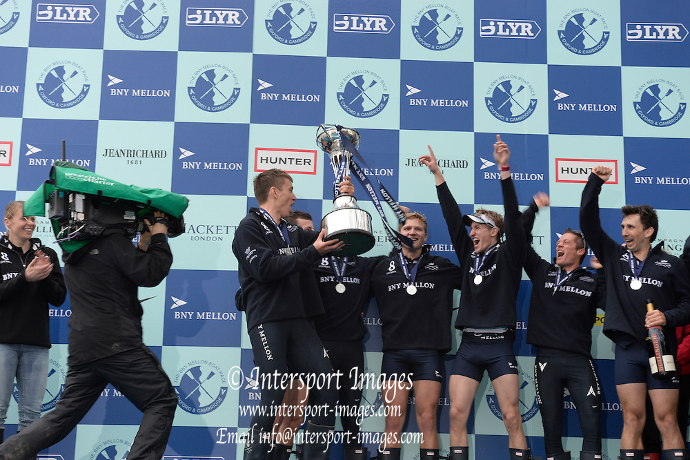 London, United Kingdom.  Oxfored celebrate, with coach, Sean BOWDEN, after winning the 2014 Varsity Boat Race between Oxford University and Cambridge University Boat Clubs over the  Putney to Mortlake  Championship Course,  River Thames;    - Sunday  - 06/04/2014  [Mandatory Credit; Peter SPURRIER/Intersport Images].