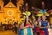 Catholic faithful dressed as Aztec warriors lead a procession from the Cathedral Basilica of St. Francis of Assisi celebrating our Lady of Guadalupe December 11, 2015 in Santa Fe, New Mexico. Guadalupanos as the devotees are known, celebrate the apparitions of the Virgin Mary to an Aztec peasant at Tepeyac, Mexico in 1531.