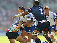 Samoa Kahn Fotuali'i passes under pressure during the Rugby World Cup 2015 match between Samoa and USA at the Brighton Community Stadium, Falmer, United Kingdom on 20 September 2015.