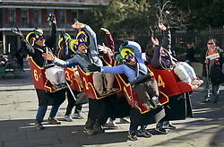 09 February 2016. New Orleans, Louisiana.<br /> Mardi Gras Day. A group dressed as a collective roller coaster go through the hilarious actions of a ride. Some of the many bright and colourful costumes in the French Quarter. <br /> Photo©; Charlie Varley/varleypix.com