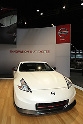 08  February 2013: 2013 Nissan 370Z.  Chicago Auto Show, Chicago Automobile Trade Association (CATA), McCormick Place, Chicago Illinois<br /> <br /> 2013 NISSAN 370Z: It made sense for Nissan to stage the world debut of the stunning 2013 Nissan 370Z at last year's Chicago Auto Show, since the Windy City Metro area is one of Nissan's top markets. Returning to woo the crowds during the 105th edition of the annual event, the iconic Nissan Z continues to offer legendary performance in Coupe, Roadster and NISMO Z configurations. All 2013 models have spiced-up front fascia with vertical LED daytime running lights, revised 18-and 19-inch aluminum-alloy wheels, red-finished brake calipers, Euro-tuned shock absorbers and two new exterior colors - Magma Red and Midnight Blue. The NISMO 370Z skips some of the body changes, but adds a new Bose Premium Audio Package with two additional speakers and two subwoofers, premium gun metallic dark-finish 19-inch wheels, Nissan GT-R style high-rigidity brake hoses and performance brake fluid. Once again, the 370Z Touring Coupe and Roadster, are powered by a 3.7 liter V-6 that produces 332 horsepower, while the NISMO Z coupe ups the horses to 350. Buyers have their choice of six-speed manual gearbox or seven-speed automatic. New available Bose package comes with six speakers, in-dash 6CD changer, Bluetoothp hands-free phone system, auto-dimming inside mirror, and HomeLink universal transceiver. The iconic Nissan Z· continues to offer legendary performance in a stunning package